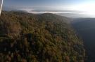 Pohľad do údolia potoka Pastovník, v pozadí obec Hertník